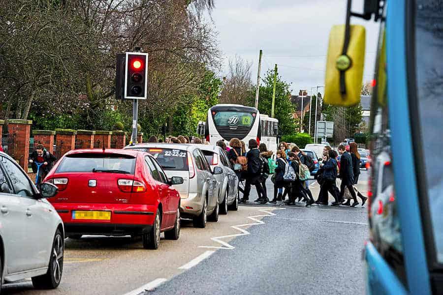 school children crossing a road