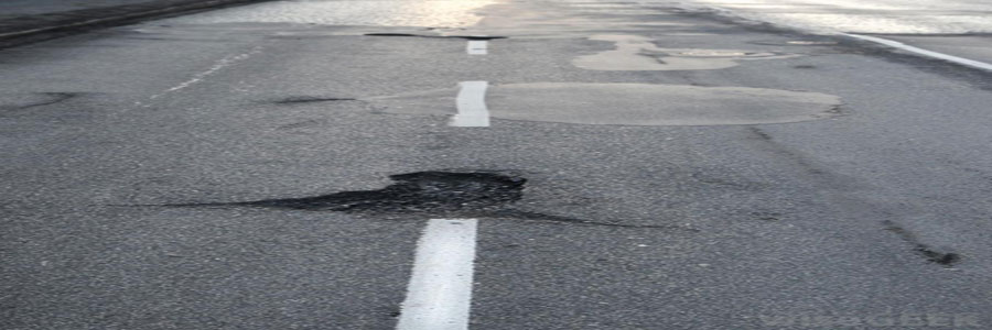 a pothole in the middle of a road